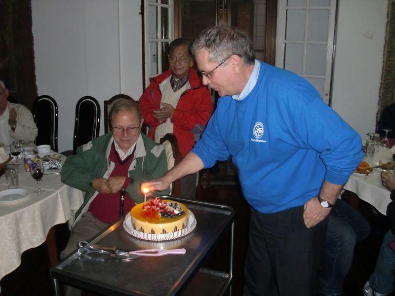 Brian lights Ron's birthday cake