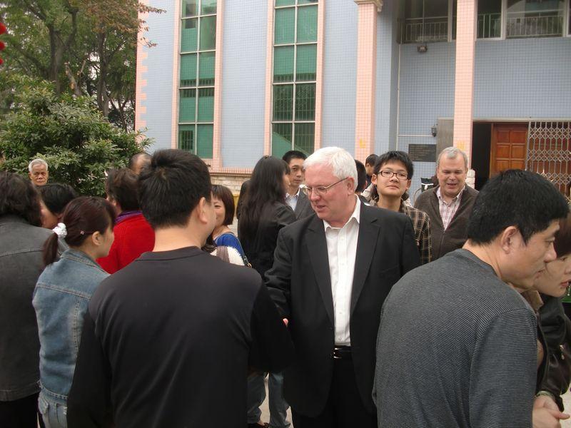 Fr.Dougherty with parishioners in Jiangmen