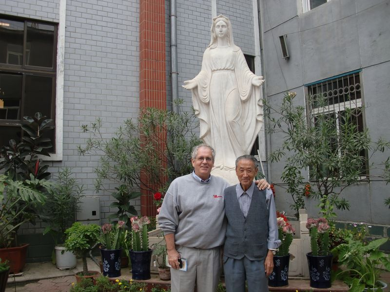 With one of the old catholics at Fushun
